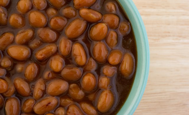 Country style baked beans in bowl close view