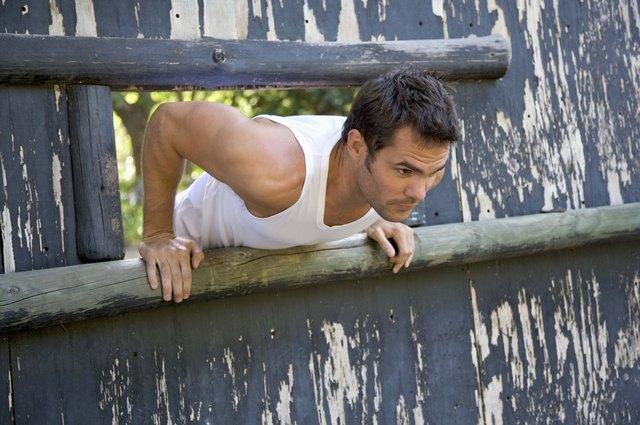 Man climbing through obstacle course