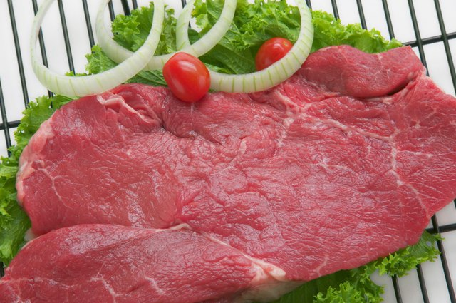 Sirloin steak with fixings on grill