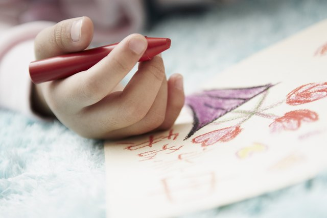 Girl Coloring with Crayon