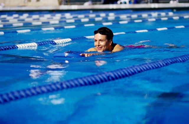 Swimmer Using Buoyancy Aid in Pool