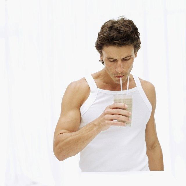 mid adult man drinking a milkshake