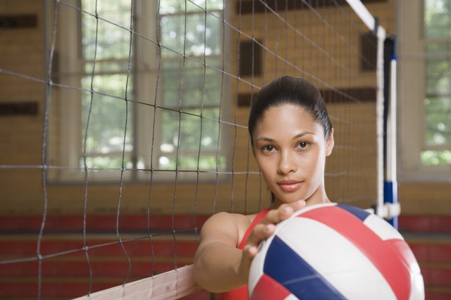 Serious volleyball player holding ball
