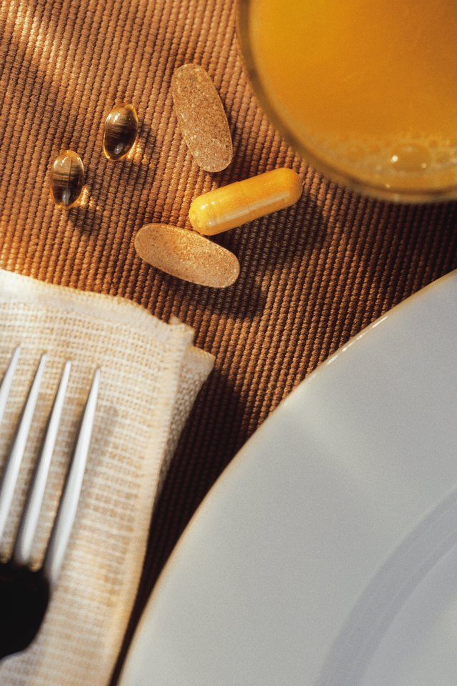 Breakfast setting with vitamins and orange juice