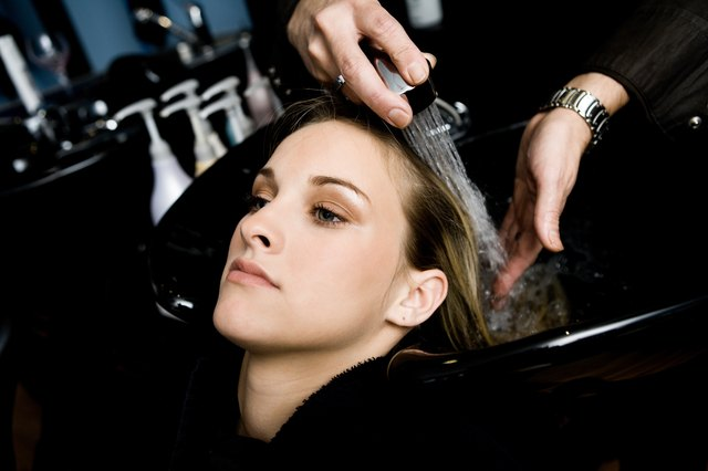 Woman getting hair washed in beauty salon