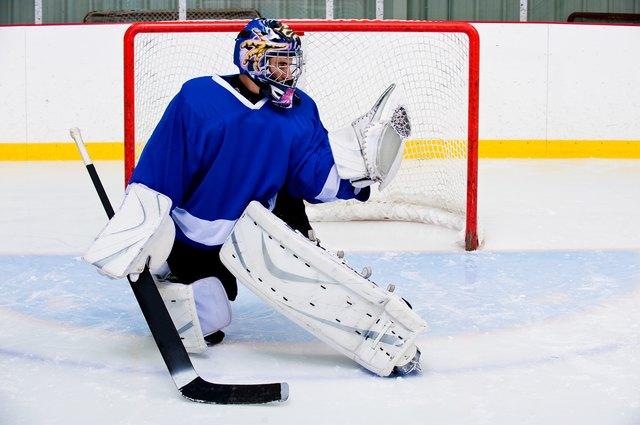 Ice hockey goalie in rink