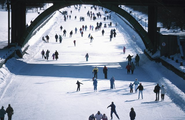 People ice skating outdoors, Ottawa, Canada