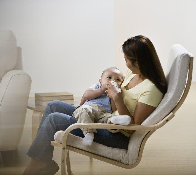 Asian mother feeding baby