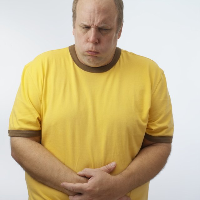 Man with hands on stomach, upper half,