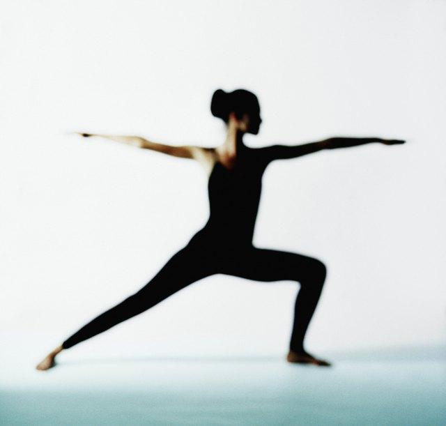 Woman in warrior II yoga position