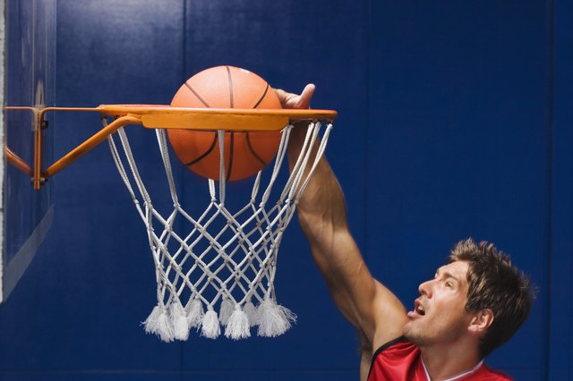 Man dunking basketball