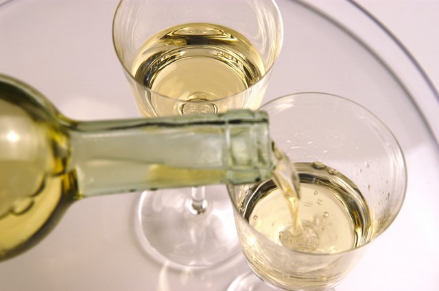 Pouring wine in to glasses, close up