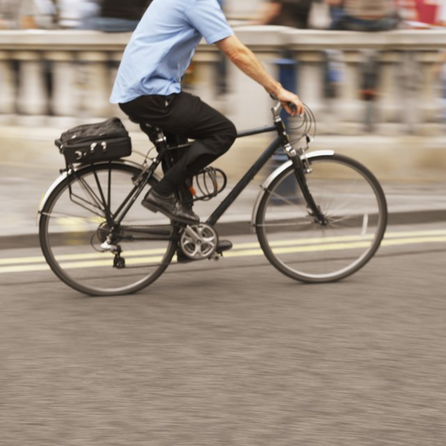 side profile of a man cycling on the street