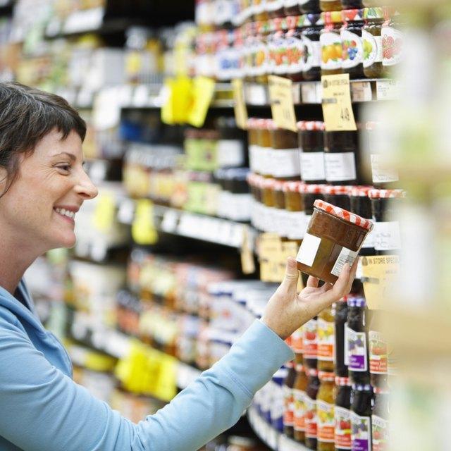 Woman Selecting Jam at Store