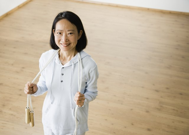 Asian woman holding jump rope