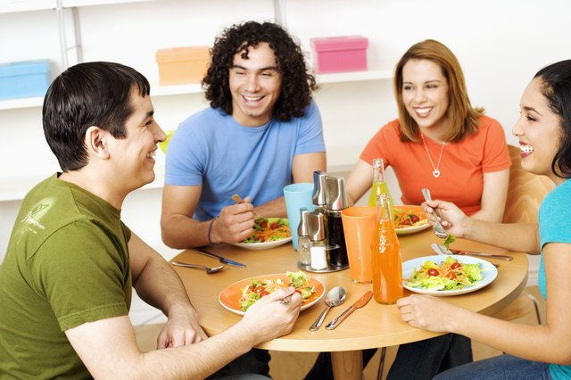 Two young couples eating food
