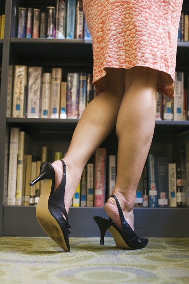 Woman's legs in library