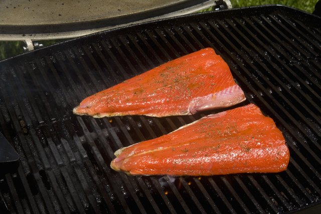 Barbecue scene, Salmon steaks on the grill.