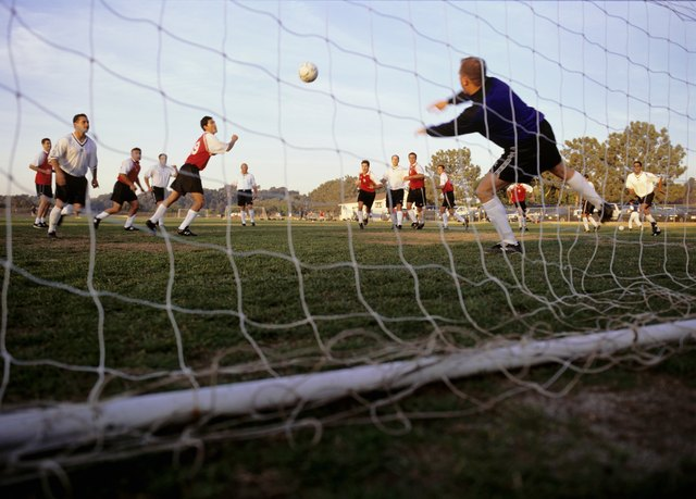 Goalkeeper making dash towards ball, low angle view