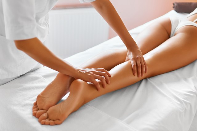 Body Care. Close-up of Woman getting Spa Treatment. Legs Massage