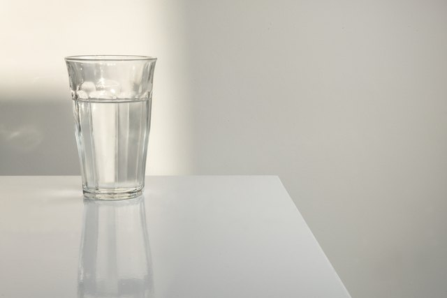 Glass of water on white table