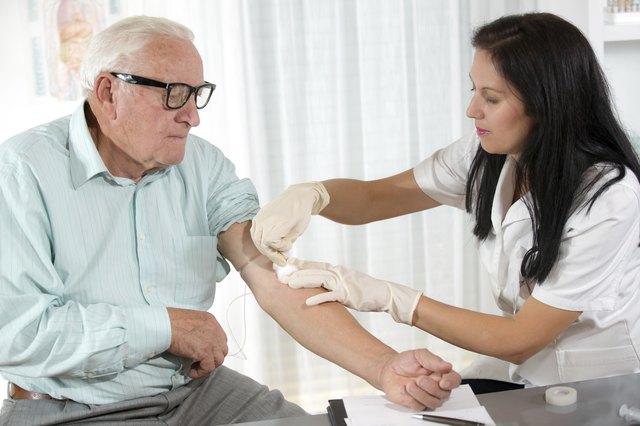 Blood sampling by an older man