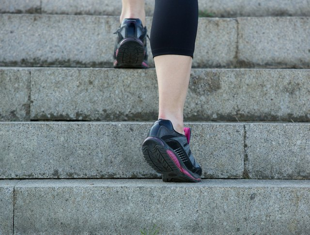 Young sport woman walking upstairs in gym shoes