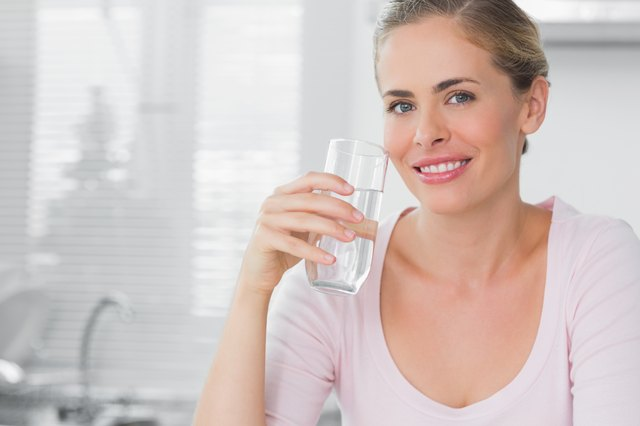 Woman holding glass of water