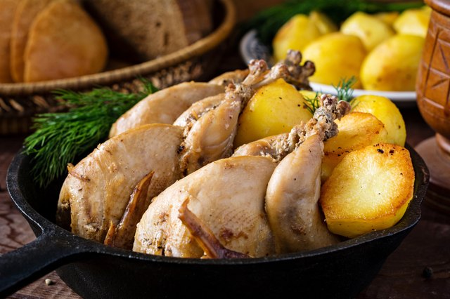 Roasted whole chicken and potatoes