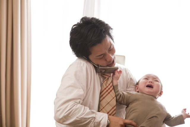 Baby Girl Pulling Cellular Phone from Father