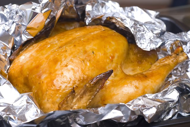 juicy golden chicken in foil