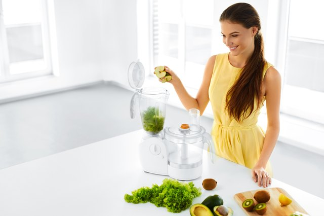 Healthy Lifestyle. Happy Vegetarian Woman Making Detox Smoothie.