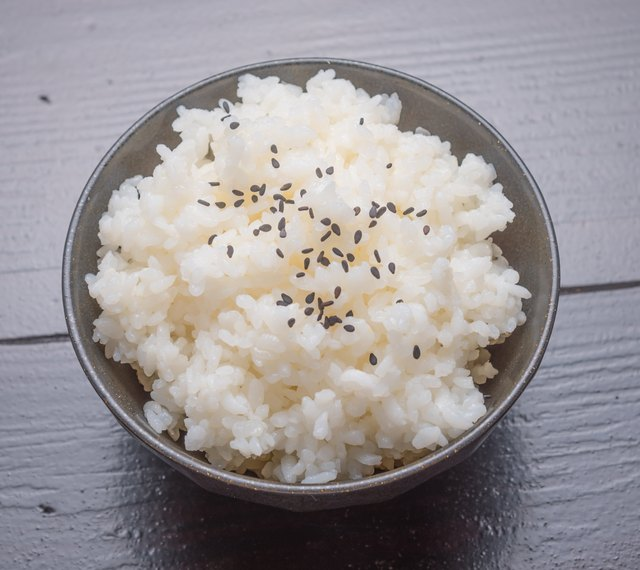 cooked rice with black sesame on bowl