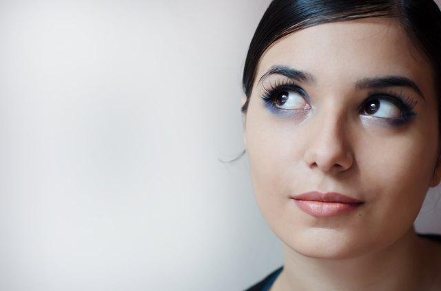 Pensive beautiful woman.