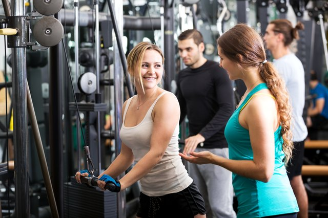 Active people having weightlifting training