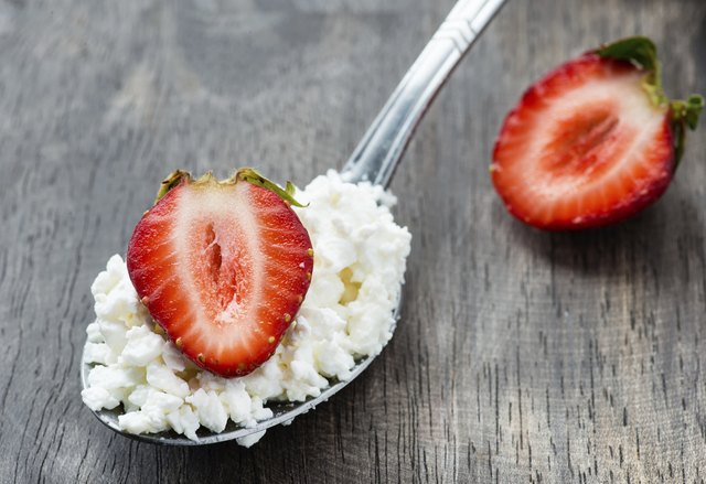 Strawberry and cottage cheese in spoon