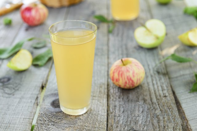 Fresh homemade apple juice and apples