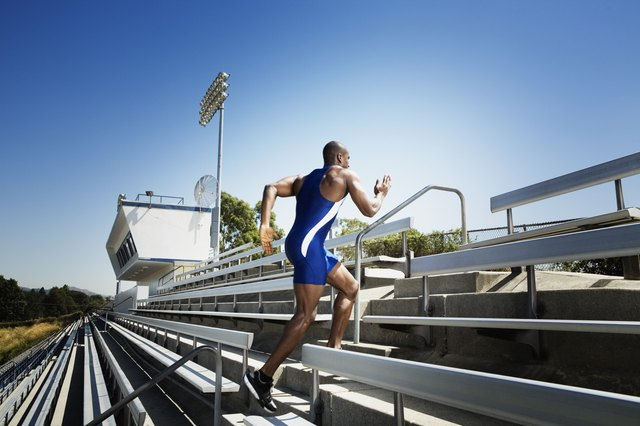 Athletic man running up bleachers