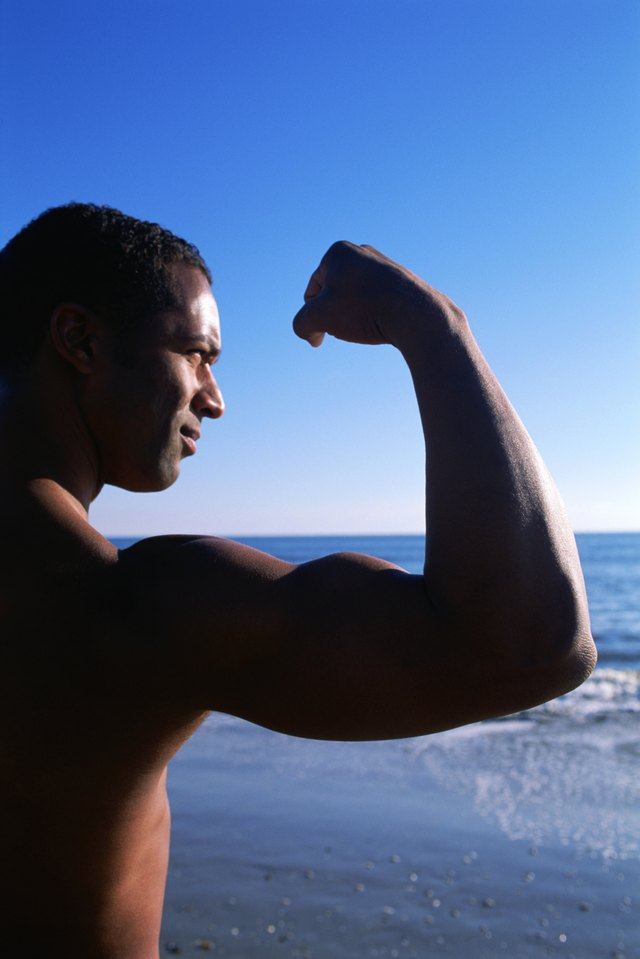 Man flexing near coast