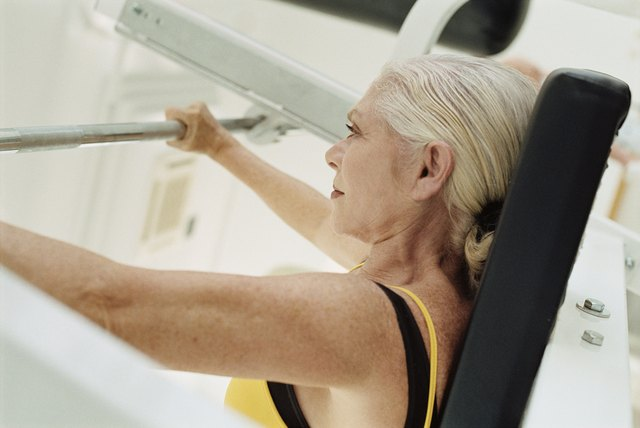 Senior woman weight training in a gym