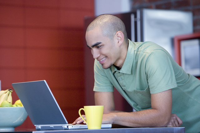 African American man looking at laptop