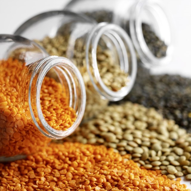 Colorful lentils with glass jars