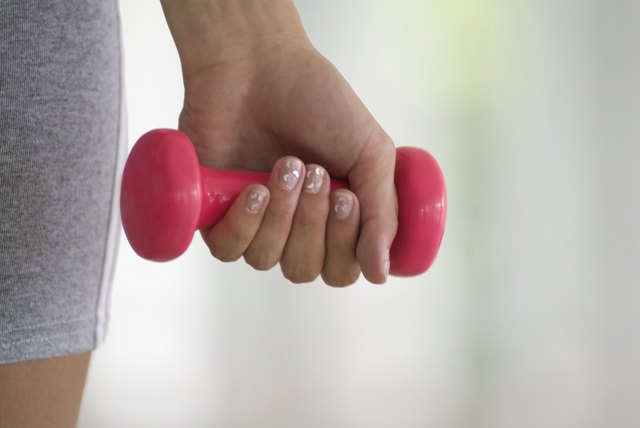 Person using hand weight, close-up