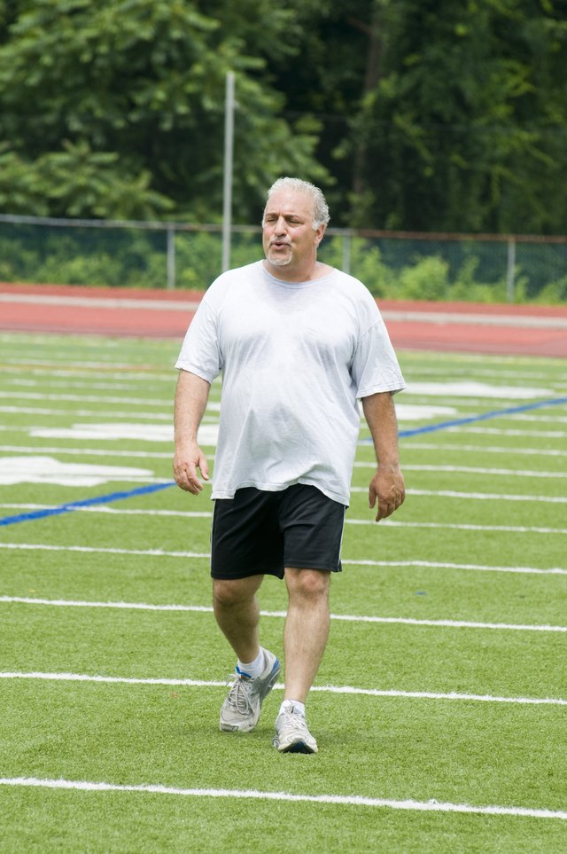 middle age man exercising on sports field