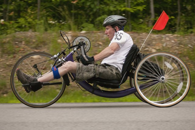 Man with spinal cord injury participating in a handcycle race
