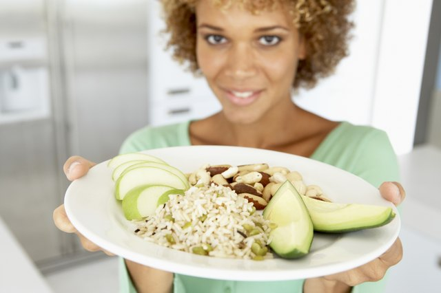 Mid Adult Woman Holding A Plate With Healthy Food