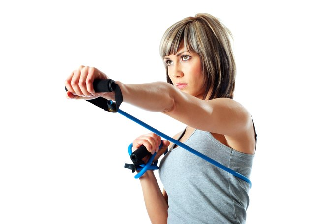 Sportswoman with resistance band