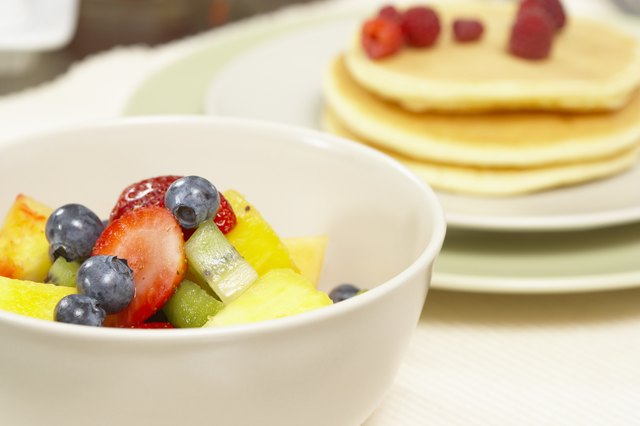 Fresh fruit in bowl and on pancakes