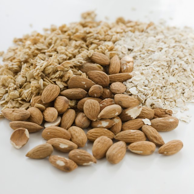 Close up of almonds, granola and oats