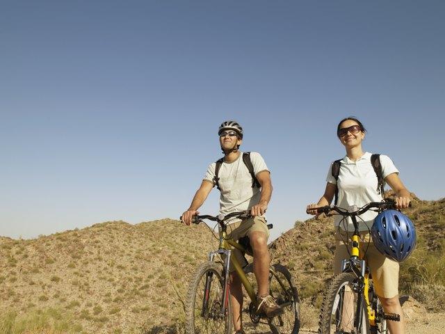 Hispanic couple on scenic bicycle ride
